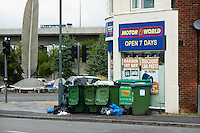 Rubbish building up during a two week strike over new contracts and pay cuts by Southampton dustmen. In the background is the Itchen Bridge.  Toll collectors for the bridge are on strike too.