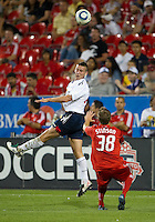 July 21, 2010  Bolton Wanderer Sean Davis No. 23 and Toronto FC Matt Stinson No. 38  in action during the Carlsberg Cup match between the Bolton Wanderers FC and Toronto FC at BMO Field in Toronto..Th Bolton Wanderrs FC won 4-3 on penalty kicks.