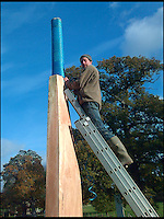 BNPS.co.uk (01202 558833)<br /> Pic: SteveJones/BNPS                                <br /> <br /> Bruce Kerry adds the large grip to the bat.<br /> <br /> A village cricket club has turned a beloved tree that has stood on the boundary of their ground for 125 years into a giant carving of a cricket bat after it was condemned.<br /> <br /> The 16ft tall wooden bat took a tree surgeon and an assistant 18 months to carve after members of Shobrooke Park Cricket Club couldn't bring themselves fell the storm-damaged Scots Pine.<br /> <br /> The tree was planted on the eastern edge of the boundary when the club in Crediton, Devon, was established in 1890 and has been a feature ever since.
