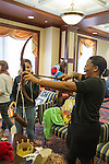 Anna-Kaye Roure pretends to shoot an arrow during the Halloween costume exchange put on my SOUL.