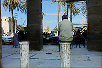 Tripoli, Libya, August 24, 2011.A Tripoli inhabitant watches jubilant rebels on Green Square, already renamed 'Martyrs Square..