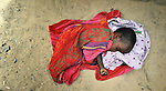 A child sleeps in the sand in Timbuktu, a city in northern Mali which was seized by Islamist fighters in 2012 and then liberated by French and Malian soldiers in early 2013.