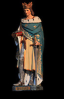 Polychrome sculpture of Saint Louis, or King Louis IX of France, wearing a fleur de lys crown, in the Collegiale Notre-Dame de Poissy, a catholic parish church founded c. 1016 by Robert the Pious and rebuilt 1130-60 in late Romanesque and early Gothic styles, in Poissy, Yvelines, France. Saint Louis was baptised here in 1214. The Collegiate Church of Our Lady of Poissy was listed as a Historic Monument in 1840 and has been restored by Eugene Viollet-le-Duc. Picture by Manuel Cohen