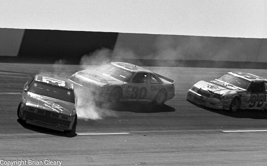 Brad Teague, Michael Waltrip and Benny Parsons crash in the Transouth 500 at Darlington Raceway in Darlington, SC on March 20, 1988. (Photo by Brian Cleary/www.bcpix.com)