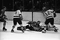 California Golden Seals vs Chicago Black Hawks 1970<br />Bill Hickey and Gary Jarrett score against Hawks goalie Gerry Desjardins. Hawks #2 Bill White. (photo by Ron Riesterer)