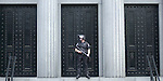 A riot cop stands guard outside the U.S. Courthouse in Savannah Ga., during protests for the G-8 Summit being held in nearby St. Simons Island.