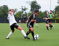 Yasmin Bunter (17) of the Virginia Beach Piranhas sprints away from Nicole Marks (7) of the Fredericksburg Impact during the game at the University of Mary Washington Battleground Stadium in Fredericksburg, VA.   The Virginia Beach Piranhas defeated the Fredericksburg Impact, 2-0, in a weather shortened game.