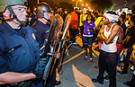 BATON ROUGE, LA -JULY 08:  Protesters face off with Baton Rouge police about the Alton Sterling shooting in Baton Rouge, Louisiana July 8, 2016.  Sterling was shot and killed by police on July 5, 2016 in Baton Rouge, Louisiana. (Photo by Mark Wallheiser/Getty Images)