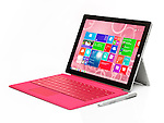 Microsoft Surface Pro 3 tablet computer with pink keyboard isolated on white background