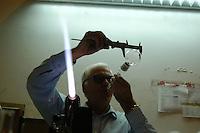 """Artigiani a San Lorenzo , quartiere storico di Roma. """" Vetro Scientifica s.r.l."""".L'azienda continua la sua attività nel tradizionale settore della lavorazione soffiata della vetreria da laboratorio.Il titolare Giuseppe Russo.Craftsmen in San Lorenzo, historic district of Rome. """" Vetro Scientifica s.r.l."""" .The company continues its work in the field of traditional processing of blown glass for scientific laboratory....."""