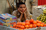 A boy sells produce in a market in Lahore, Pakistan.