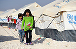 Girls walking through the Zaatari Refugee Camp, located near Mafraq, Jordan. Opened in July, 2012, the camp holds upwards of 50,000 refugees from the civil war inside Syria. International Orthodox Christian Charities and other members of the ACT Alliance are active in the camp providing essential items and services.