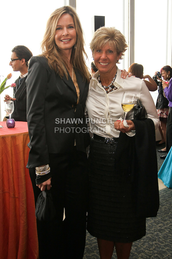 Juli Boeheim and guest, pose at the Syracuse University 2011 Fashion Show reception, at One Chase Plaza, May 19 2011.