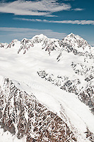 Aerial views of Fox Glacier with Mt. Tasman 3497m on left and Mt. Cook 3754m right dominating skyline, Westland National Park, West Coast, New Zealand