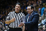 29 December 2014: Duke head coach Mike Krzyzewski (right) talks to referee Wally Rutecki (left). The Duke University Blue Devils hosted the University of Toledo Rockets at Cameron Indoor Stadium in Durham, North Carolina in a 2014-16 NCAA Men's Basketball Division I game. Duke won the game 86-69.