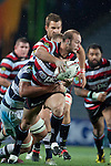 David Bason looks to off load the ball as he gets tackled by Steven Luatua. ITM Cup Round 7 rugby game between Auckland and Counties Manukau, played at Eden Park, Auckland on Thursday August 11th..Auckland won 25 - 22.
