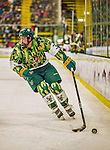 24 November 2013: University of Vermont Catamount Forward Chris McCarthy, a Senior from Collegeville, PA, in second period action against the University of Massachusetts Minutemen at Gutterson Fieldhouse in Burlington, Vermont. The Cats wore special camouflage jerseys to celebrate Military Appreciation Day. The game-worn jerseys were auctioned off with proceeds benefiting the Vermont Veterans Fund (VVF). The Catamounts shut out the Minutemen 2-0 to sweep the 2-game home-and-away weekend Hockey East Series. Mandatory Credit: Ed Wolfstein Photo *** RAW (NEF) Image File Available ***