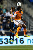 Brian Carroll (7) of the Philadelphia Union goes up for a header with Giles Barnes (23) of the Houston Dynamo. The Houston Dynamo defeated the Philadelphia Union 1-0 during a Major League Soccer (MLS) match at PPL Park in Chester, PA, on September 14, 2013.