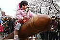Apr 04, 2010 - Kawasaki, Japan - A kid rides on a wooden phallic figure during the Kanamara Matsuri (Festival of the Steel Phallus) held in Wakamiya Hachimangu Shrine on April 4, 2010 in Kawasaki, Japan. The annual feritility festival, held traditionally the first Sunday in April, is said to encourage fertility and bring harmony to married couples. The festival has also become somewhat of a tourist attraction and is used to raise money for HIV research and awareness of AIDS prevention.