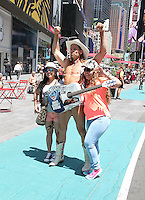 NEW YORK, NY - JUNE 21: The Naked Cowboy poses with tourists in the green zone on the first day of NYPD (New York Police Department) enforcement of the new pedestrian zones in Times Square where costumed characters and those selling bus or show tickets are required to solicit only in the designated green zone in New York, New York on June 21, 2016.  Photo Credit: Rainmaker Photo/MediaPunch