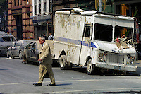 13 September 2001: A business man walks in front of a destroyed delivery truck holding a briefcase surrounded by ashes and crushed cars.  Terrorist attack on the America's.  Lower Manhattan, NY. Area surrounding ground zero where the World Trade Centers WTC once stood only hours after they fell to the ground in New York.  Islamic terrorist Osama bin Laden declares The Jihad or Holy War against The United States of America on September 11, 2001. Headline news photos available for editorial use.