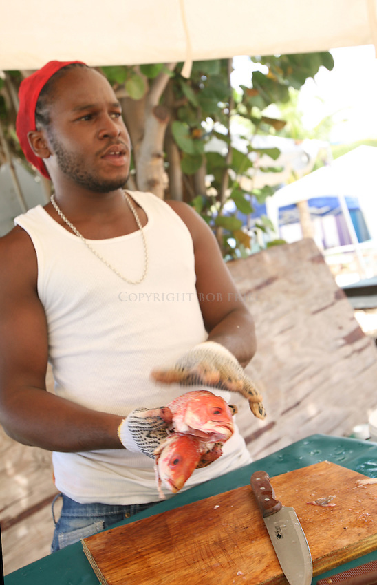 Francis Bellamy of Bellamy's Cocktail Bar & Grill prepares Red Snapper for Friday night's fish fry.Oistin's.Christ Church Parish.Barbados