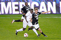 Shamar Shelton (16) of the Cincinnati Bearcats and Daniel Fabian (19) of the Providence Friars. The Providence Friars defeated the Cincinnati Bearcats 2-1 during the semi-finals of the Big East Men's Soccer Championship at Red Bull Arena in Harrison, NJ, on November 12, 2010.