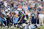 Seattle Seahawks' running back Robert Turbin runs pass an attempted tackle by the Tennessee Titans cornerback Alterraun Verner in a pre-season game at CenturyLink Field in Seattle, Washington on August 11, 2012. ©2012. Jim Bryant Photo. All Rights Reserved...