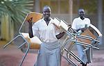 Students carry chairs to class at the Loreto Secondary School in Rumbek, South Sudan. The school is run by the Institute for the Blessed Virgin Mary--the Loreto Sisters--of Ireland.