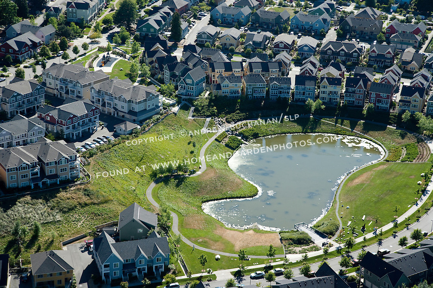 High Point, West Seattle, WA; An aerial view of High Point, a mixed housing development in West Seattle, with stormwater retention pond.