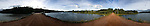 Panorama of red dirt road, Prince Edward Island, Canada.
