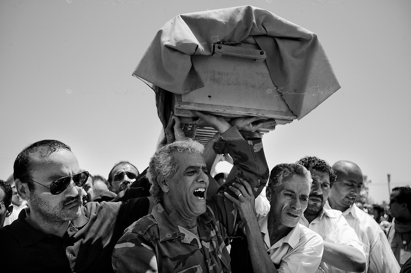 Surman, Libya, June 22, 2011.Funerals for the 12 family members (including several women and 3 children) of Major General Khweidi Al Hamidi, killed during a massive NATO night bombing of his large estate alledgedly used as a military control and command center.