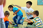 """THIS PHOTO IS AVAILABLE AS A PRINT OR FOR PERSONAL USE. CLICK ON """"ADD TO CART"""" TO SEE PRICING OPTIONS.   Roma children playing in the Nasa Radost preschool in Smederevo, Serbia."""