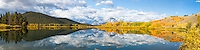 Oxbow Bend Autumn Panorama.  A beautiful morning in Grand Teton National  Park, a windless morning fosters a reflection of autumn color and the Grand Tetons upon the calm water of the Snake River. <br />