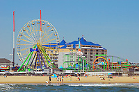 Beach, boardwalk and rides of Ocean City, Maryland viewed from the ocean.