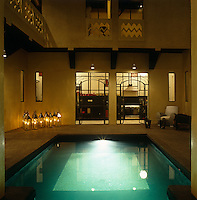 The central courtyard of this riad has been transformed by the introduction of a floodlit swimming pool