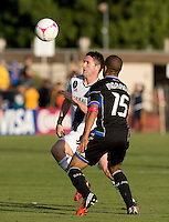 Robbie Keane of Galaxy controls the ball away from Justin Morrow of Earthquakes during the game at Buck Shaw Stadium in Santa Clara, California on October 21st, 2012.  San Jose Earthquakes and Los Angeles Galaxy tied at 2-2.