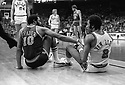 (1979) New York Knicks guard Walt Frazier helps up Chicago Bulls guard Norm Van Lier after a collision on the court.
