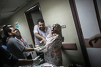 In this Monday, Jul. 08, 2013 photo, a relative of a wonded person grieves bereaved at the Madinet Nasr Atamineh Sah hospital after several wounded and dead arrived from Republican Guard heardquarters were got shot allegedly by Egyptian army forces in Cairo, Egypt. (Photo/Narciso Contreras).