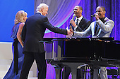 United States Vice President Joe Biden (2nd L) and Dr. Jill Biden (L) shake hands with actor and musician Jamie Foxx (R) after he sang while they danced at the Inaugural Ball at the Walter Washington Convention Center January 21, 2013 in Washington, DC. Biden and President Barack Obama started their second term by taking the Oath of Office earlier in the day during a ceremony on the West Front of the U.S. Capitol.  .Credit: Chip Somodevilla / Pool via CNP