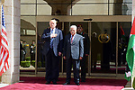 U.S. President Donald Trump and Palestinian President Mahmoud Abbas review the honor guard during a reception ceremony at the presidential headquarters in the West Bank town of Bethlehem, May 23, 2017. Photo by Thaer Ganaim