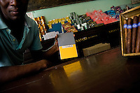 A Cuban man offers a fake of Cohiba cigars under-the-counter in a state food shop in Havana, Cuba, 16 August 2008. About 50 years after the national rebellion, led by Fidel Castro, and adopting the communist ideology shortly after the victory, the Caribbean island of Cuba is the only country in Americas having the communist political system. Although the Cuban state-controlled economy has never been developed enough to allow Cubans living in social conditions similar to the US or to Europe, mostly middle-age and older Cubans still support the Castro Brothers' regime and the idea of the Cuban Revolution. Since the 1990s Cuba struggles with chronic economic crisis and mainly young Cubans call for the economic changes.