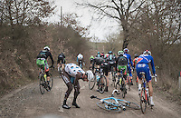 Gediminas Bagdonas (LTU/AG2R-LaMondiale) crashes &amp; is left in pain at 31km. He would soon resume the race though.<br /> <br /> 11th Strade Bianche 2017