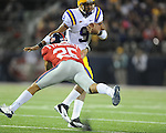 LSU quarterback Jordan Jefferson (9) breaks the attempted tackled by Ole Miss' Cody Prewitt (25) at Vaught-Hemingway Stadium in Oxford, Miss. on Saturday, November 19, 2011.