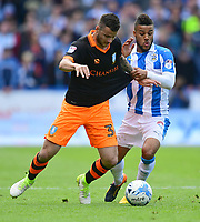 Sheffield Wednesday's Daniel Pudil shields the ball from Huddersfield Town's Elias Kachunga<br /> <br /> Photographer Chris Vaughan/CameraSport<br /> <br /> The EFL Sky Bet Championship Play-Off Semi Final First Leg - Huddersfield Town v Sheffield Wednesday - Saturday 13th May 2017 - The John Smith's Stadium - Huddersfield<br /> <br /> World Copyright &copy; 2017 CameraSport. All rights reserved. 43 Linden Ave. Countesthorpe. Leicester. England. LE8 5PG - Tel: +44 (0) 116 277 4147 - admin@camerasport.com - www.camerasport.com
