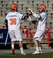 Matt White (4) and Brian Carroll (36) of Virginia celebrate a goal during the ACC men's lacrosse tournament semifinals in College Park, MD.  Virginia defeated Duke, 16-12.