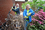 Michele Justice (left) and Janet Townsend help with landscaping at the Fourth Avenue United Methodist Church in Louisville, Kentucky, on April 24, 2014, the Ubuntu day of service before the United Methodist Women Assembly in Louisville, Kentucky. The church carries out a variety of ministries in the community, including providing food to homeless and underemployed people.