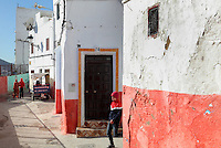 A street where the lower section of the walls is painted red, in the medina or old town of Tetouan on the slopes of Jbel Dersa in the Rif Mountains of Northern Morocco. Tetouan was of particular importance in the Islamic period from the 8th century, when it served as the main point of contact between Morocco and Andalusia. After the Reconquest, the town was rebuilt by Andalusian refugees who had been expelled by the Spanish. The medina of Tetouan dates to the 16th century and was declared a UNESCO World Heritage Site in 1997. Picture by Manuel Cohen