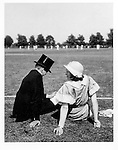 Eton boy & mother by cricket pitch, June, 1933