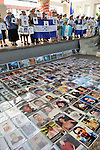 At a December 16, 2013 demonstration in the center of Tapachula, Mexico, several dozen Central Americans hold photos of family members who disappeared in Mexico. Other photos were laid out on the ground. The group, mostly mothers looking for their children, spent 17 days touring 14 Mexican states in search of their loved ones, most of whom had disappeared while following the migrant trail north or were abducted by human traffickers.